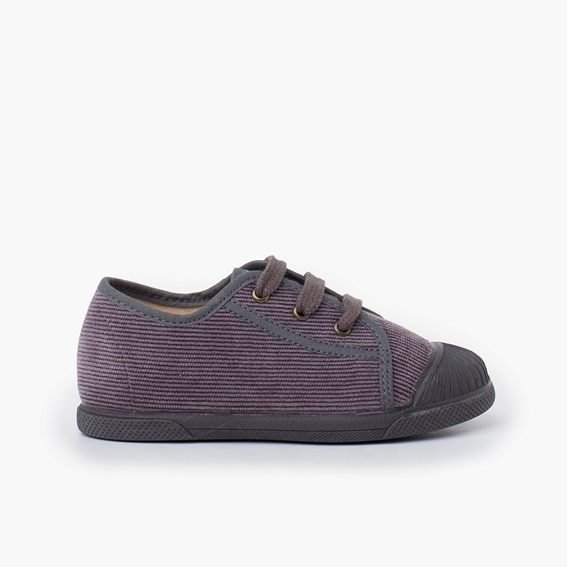 Sneaker con puntale in gomma in velluto a coste